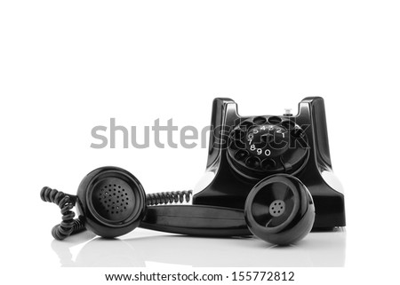 Old retro bakelite telephone with the earphone next to it. On a white background - stock photo