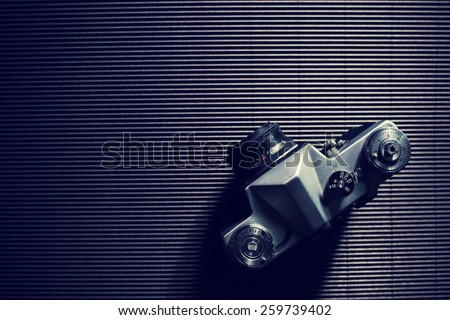 Old retro camera on vintage abstract background, vintage style effect picture  - stock photo
