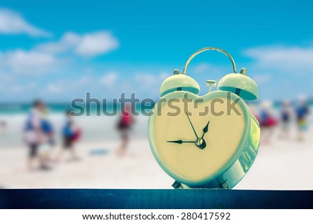 old retro clock on sand beach ,vintage color tone,abstract background to memory of last time. - stock photo