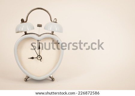 old retro clock  on white background ,vintage color tone,abstract background to memory of last time.  - stock photo