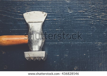 old retro kitchen axe on the blue table - stock photo