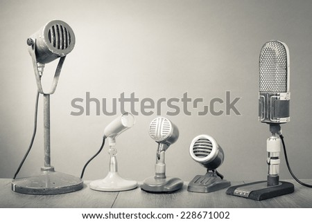 Old retro microphones for press conference. Vintage style greyscale photo - stock photo
