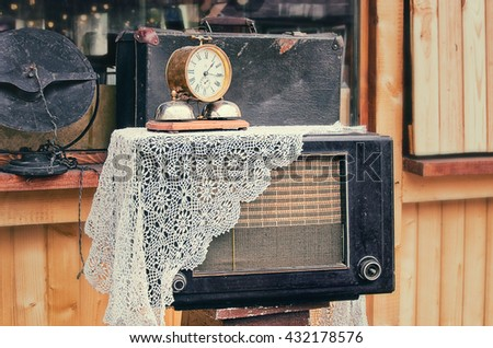 old retro objects antique alarm clock and the radios receiver, vintage image retro style effect filter