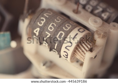 Old retro objects with numbers, in a workshop - stock photo