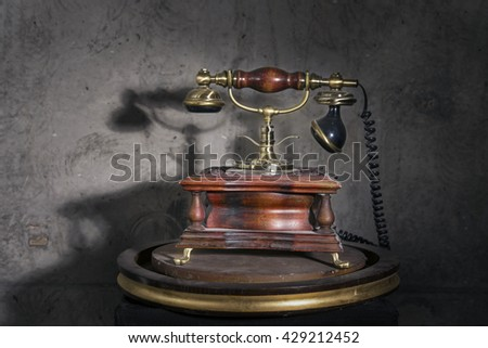 old retro phone on a stand