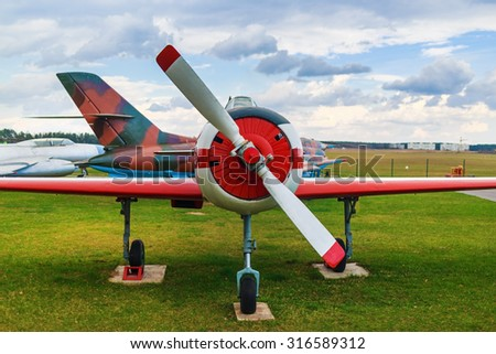 Old retro plane close-up. Front view, with the side of the fuselage and propeller with two blades. - stock photo