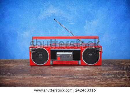 old retro radio on table blue background - stock photo