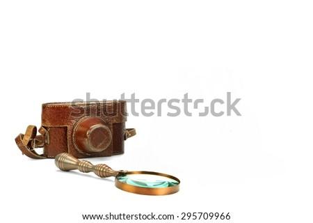 Old Retro Shabby SLR Photo Camera Case And Vintage Magnifying Glass Isolated On White Background - stock photo