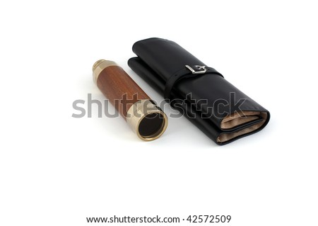 old retro spyglass with black travel case as symbol of travel - stock photo