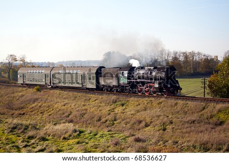 Old retro steam train passing through polish countryside