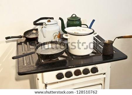 old retro stove with a frying pan and coffee maker - stock photo