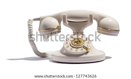 Old retro telephone with a handset and numbered dial on a white background