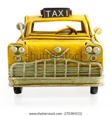 Old retro toy yellow taxi isolated on white background - stock photo