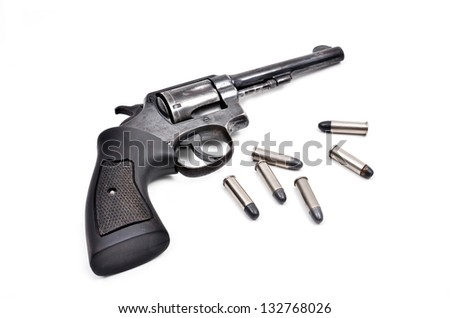 old revolver gun with bullet isolated on white background - stock photo