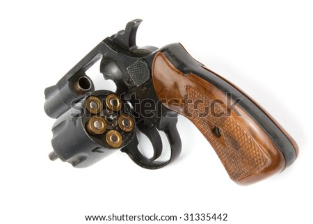 Old revolver with bullets isolated over white background