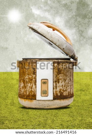 Old rice Cooker with field background in retro style - stock photo