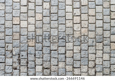 Old road paved with granite stones - stock photo