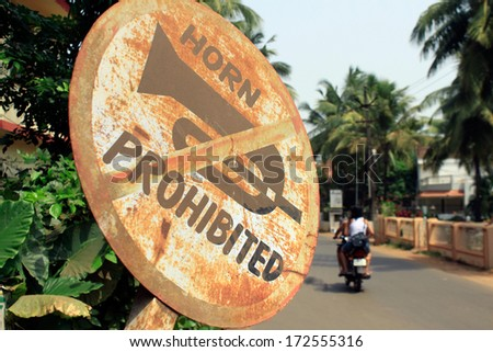 "Old road sign ""horn prohibited"" - stock photo"