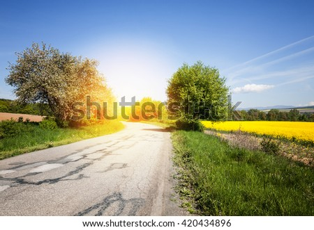 Old road through the beautiful countryside landscape - stock photo