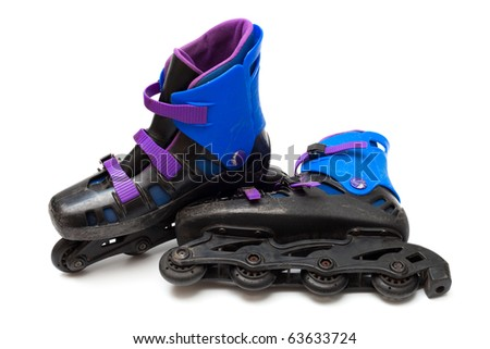 old roller blades on a white background