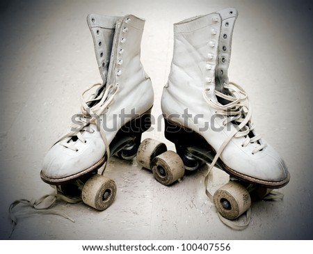 Old roller skates in vintage light - stock photo