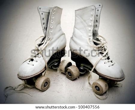 Old roller skates in vintage light - stock photo
