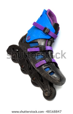old roller skates on a white background - stock photo