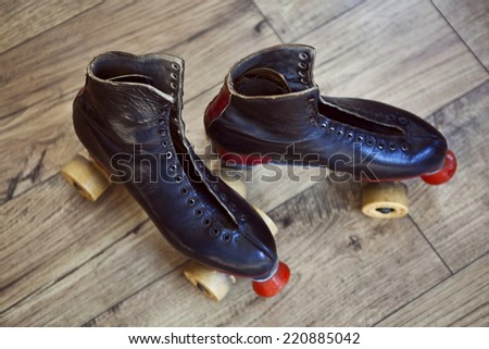 Old rollers on a wooden floor - stock photo