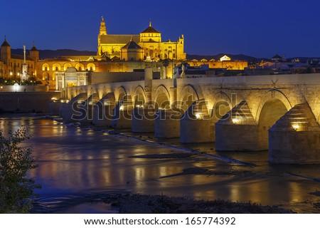 old roman bridge and tower Calahora at night, Cordoba, Andalusia, Spain - stock photo