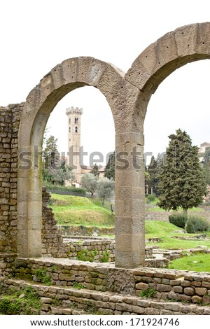 Old roman ruins and medieval towe rin Fiesole in Italy  - stock photo