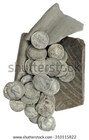 old roman silver coins on the broken pot - stock photo