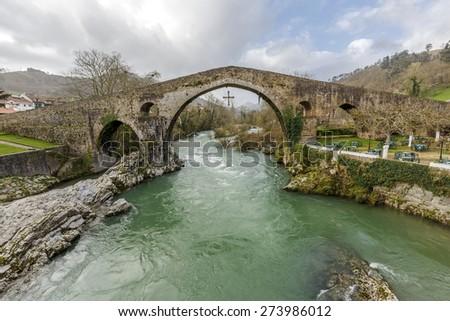 Old Roman stone bridge in Cangas de Onis, Spain  - stock photo