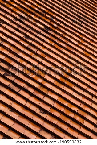 Old roof tiles made of terracotta texture. - stock photo