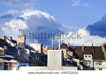 old roofs with chimneys. european style. blue sky.