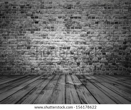 old room with brick wall, grey vintage background - stock photo