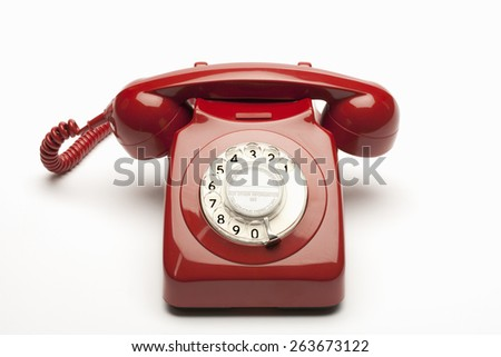 Old rotary phone - stock photo