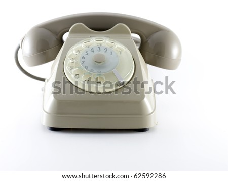 old rotating dial telephon over a white background