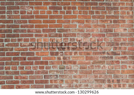 Old rough red brick wall background - stock photo