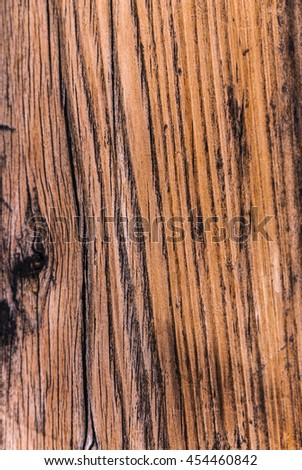 Old, roughly treated, weathered, cracked, rotten, knotted Pine plank grunge texture.