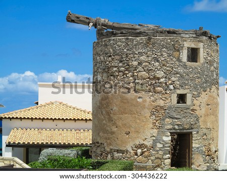 Old round medieval brown tower on Crete, Greece - stock photo