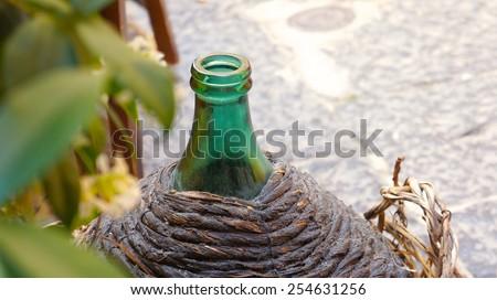 Old round wine bottle - stock photo