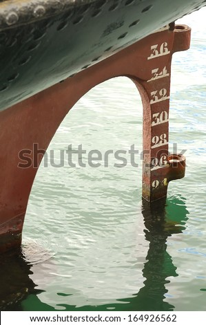 Old rudder and stern waterline of an old ship - stock photo