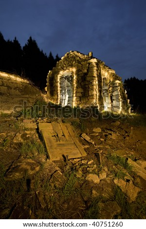 Old ruin painted with light in its natural setting - stock photo