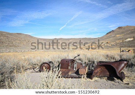 Old Ruined Car in Ghost Town - stock photo