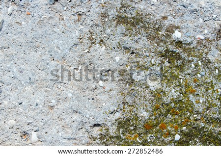 Old ruined concrete wall with traces of moss. textural composition - stock photo