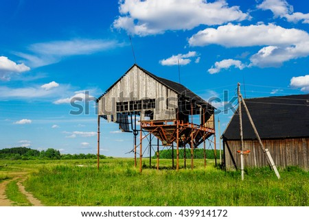 old ruined grain elevator - stock photo