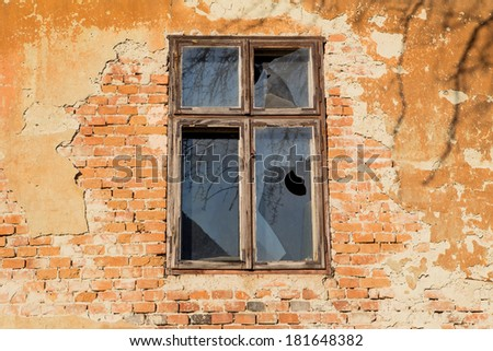 Old ruined wall with window