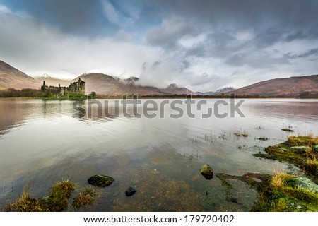 Old ruins of a castle on the lake - stock photo