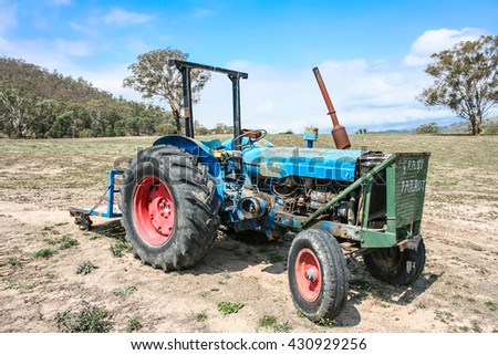 Old run down tractor in a farm paddock. Australia.