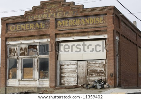 old rural abandoned general store front - stock photo